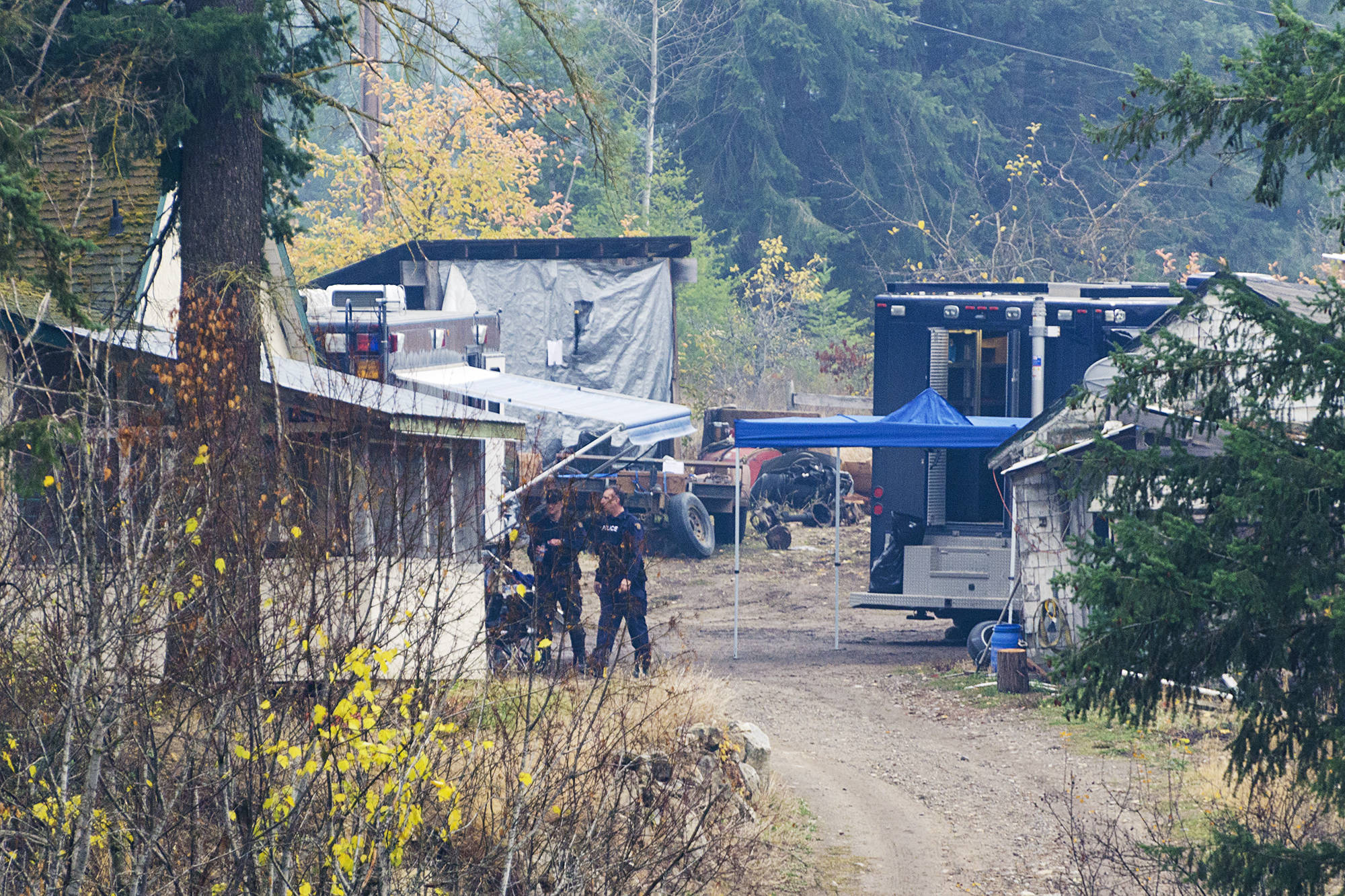 Investigators work at the Sagmoen farm in Silver Creek. - Image credit: Observer file photo.